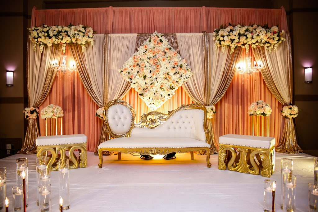 Wedding ceremony flowers with chandeliers