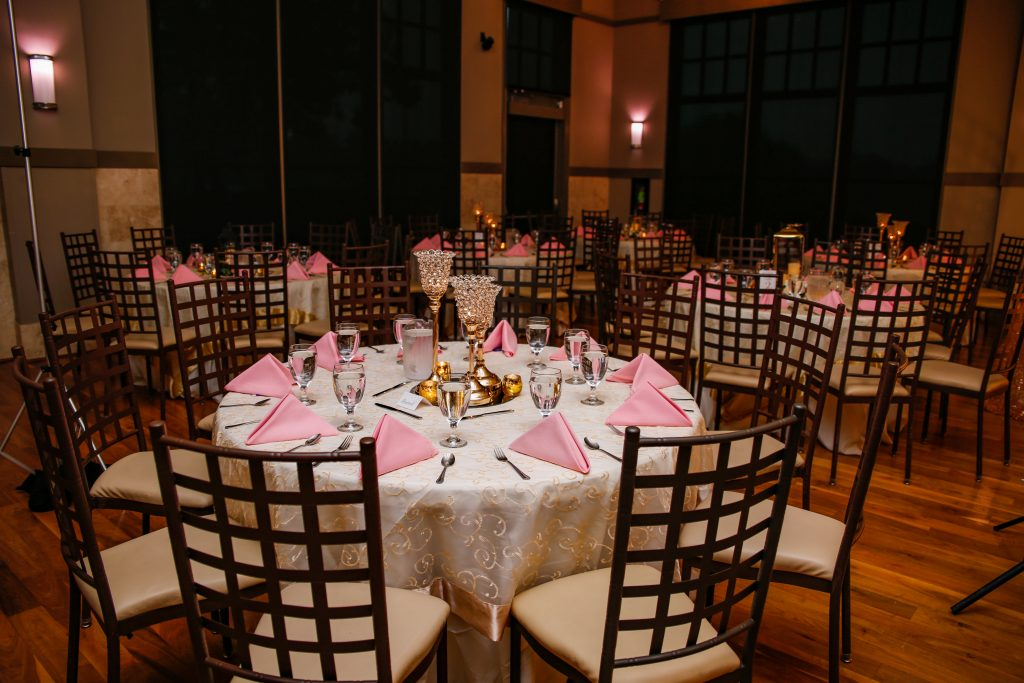 Wedding reception with pink napkins and crystal candlesticks