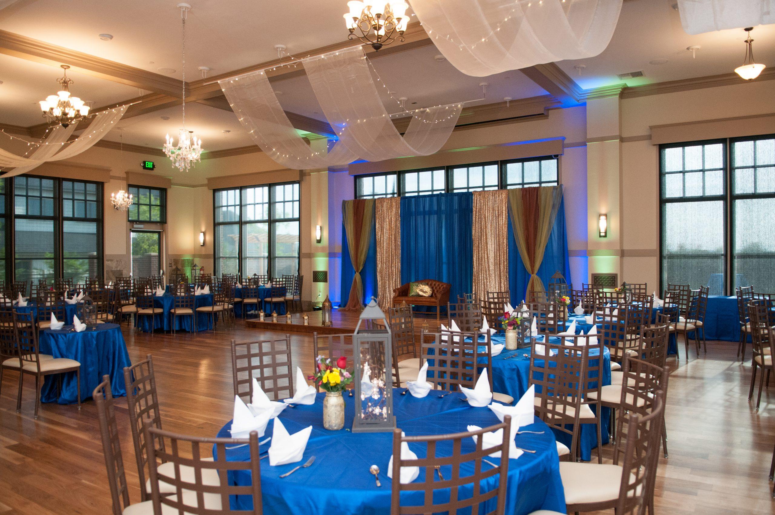 wedding reception blue linens and white napkins