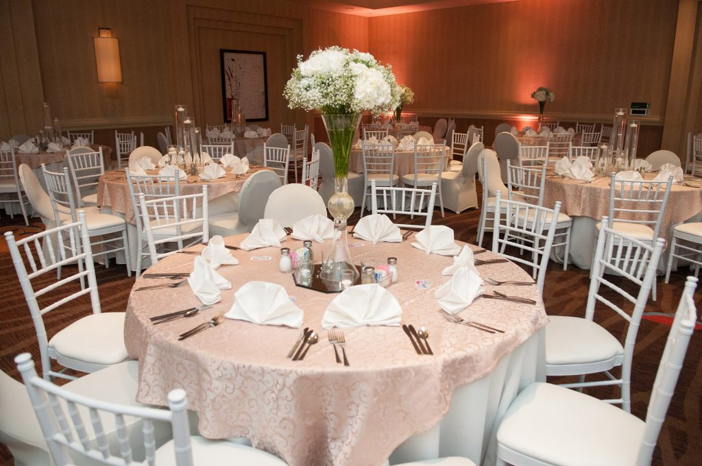 Elevated wedding flowers with hydrangea and baby's breath