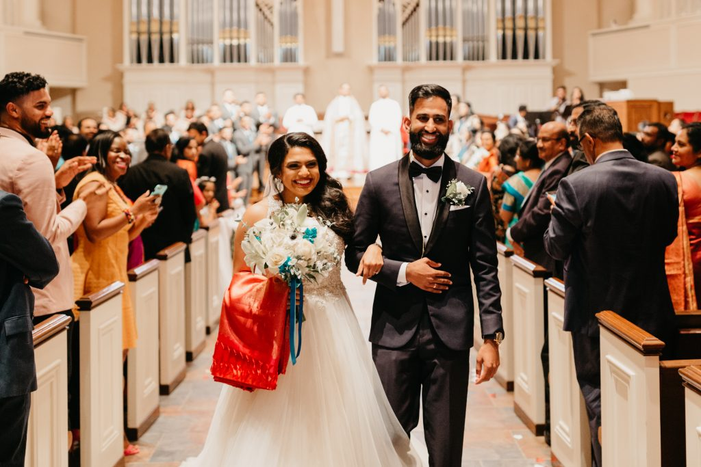 Bride and groom walking down the aisle on wedding day in Texas