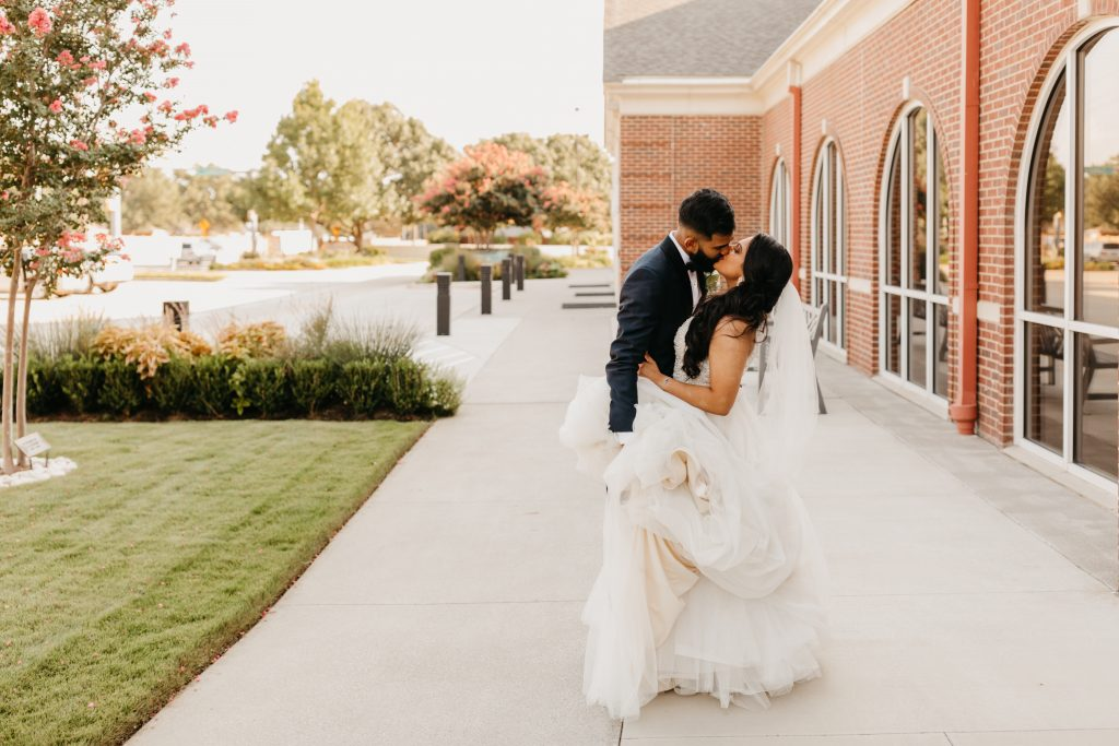 Wedding day kiss with beautiful white gown