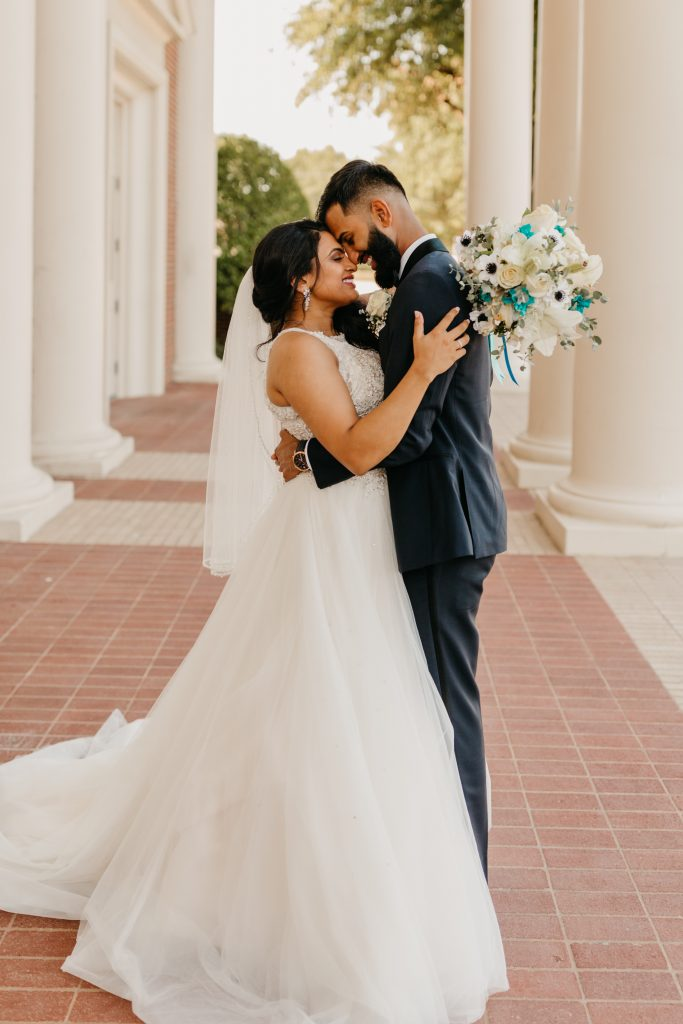 Wedding day smiles with bridal bouquet
