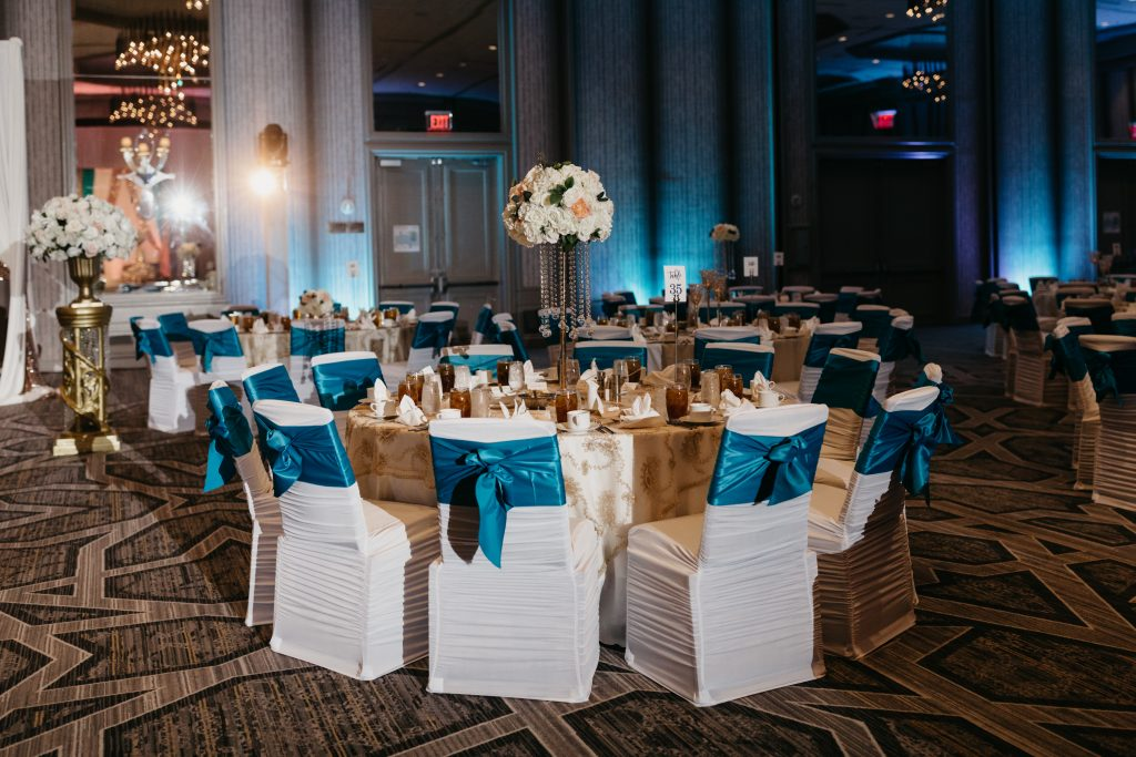 Large round wedding reception tables in ballroom