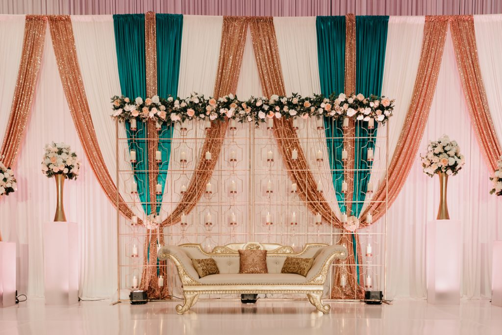 Wedding flower beam with sequin pipe and drape