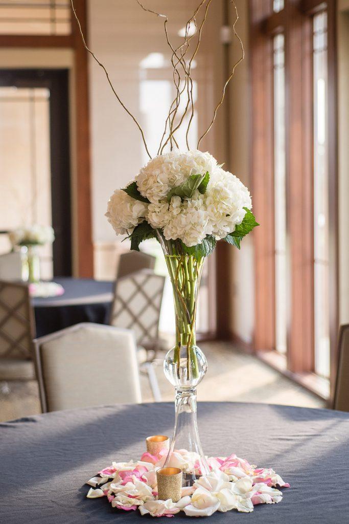 Elevated wedding flower centerpiece with white hydrangea