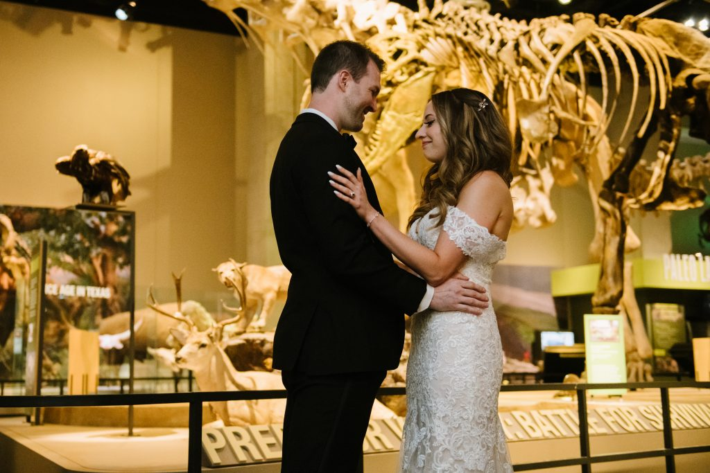 Bride and groom embrace at Perot Museum wedding