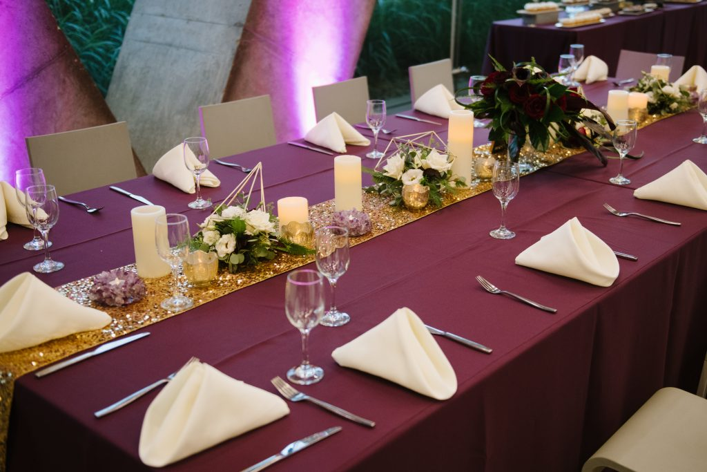 Gold table runner for rectangle wedding table with flower centerpieces