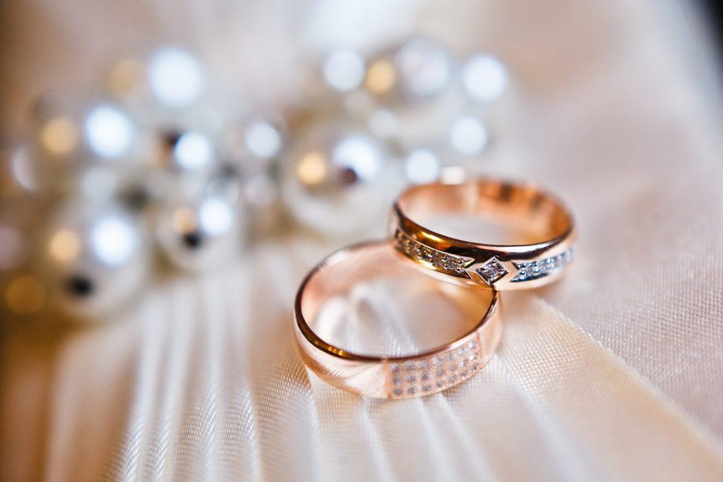 Engagement rings on wedding dress